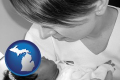 michigan an adopted baby with its adoptive mother